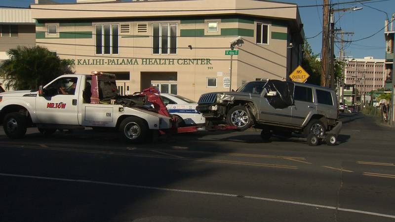 A jeep was being towed from the scene of an officer-involved shooting in Kalihi.