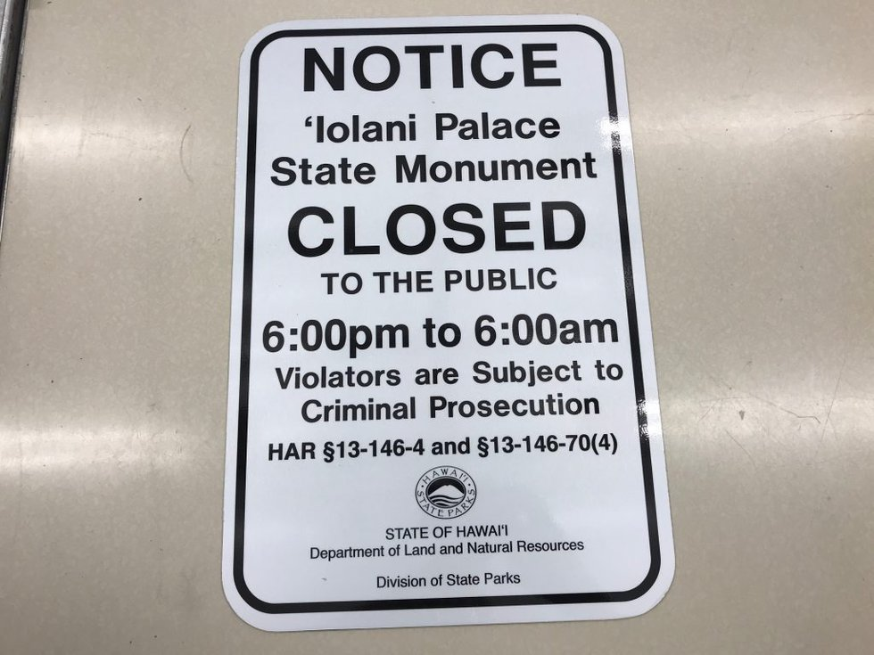 These signs list the new hours of the palace grounds.
