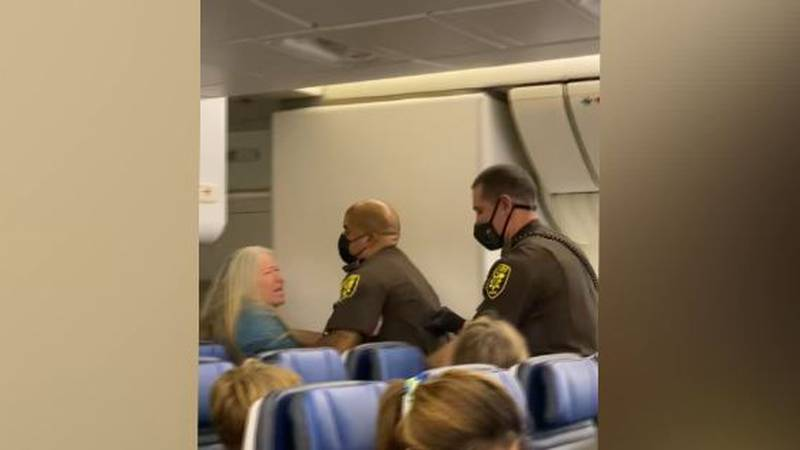 Law enforcement was called in to remove a disruptive passenger on a plane that landed in...