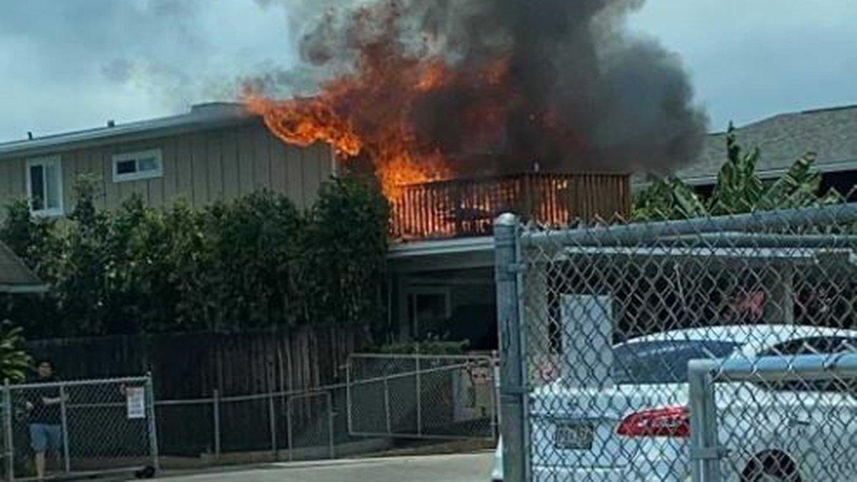 Firefighters are battling a house fire on Monsarrat Avenue.