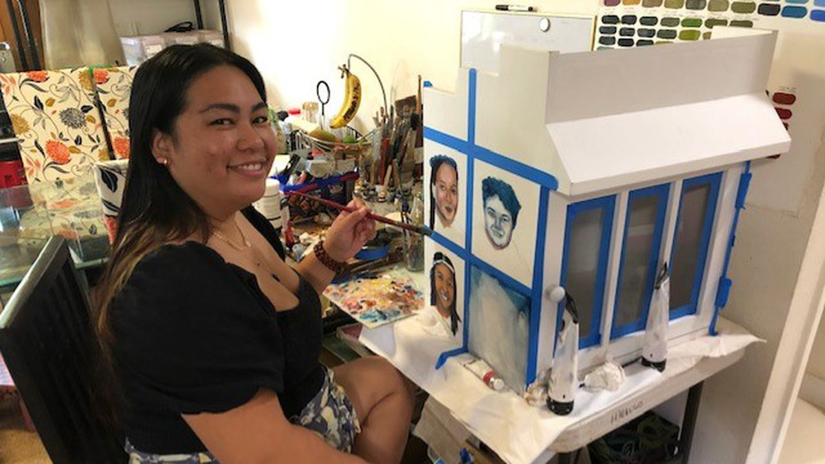 Artist Dannah Mari Hidalgo shows off the Little Free Diverse Library she's working on. The free...
