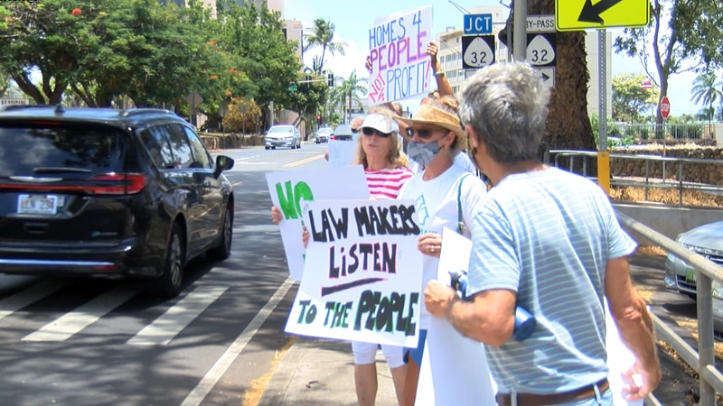 On Monday, dozens of residents chanted, held signs, and demanded more affordable housing for...