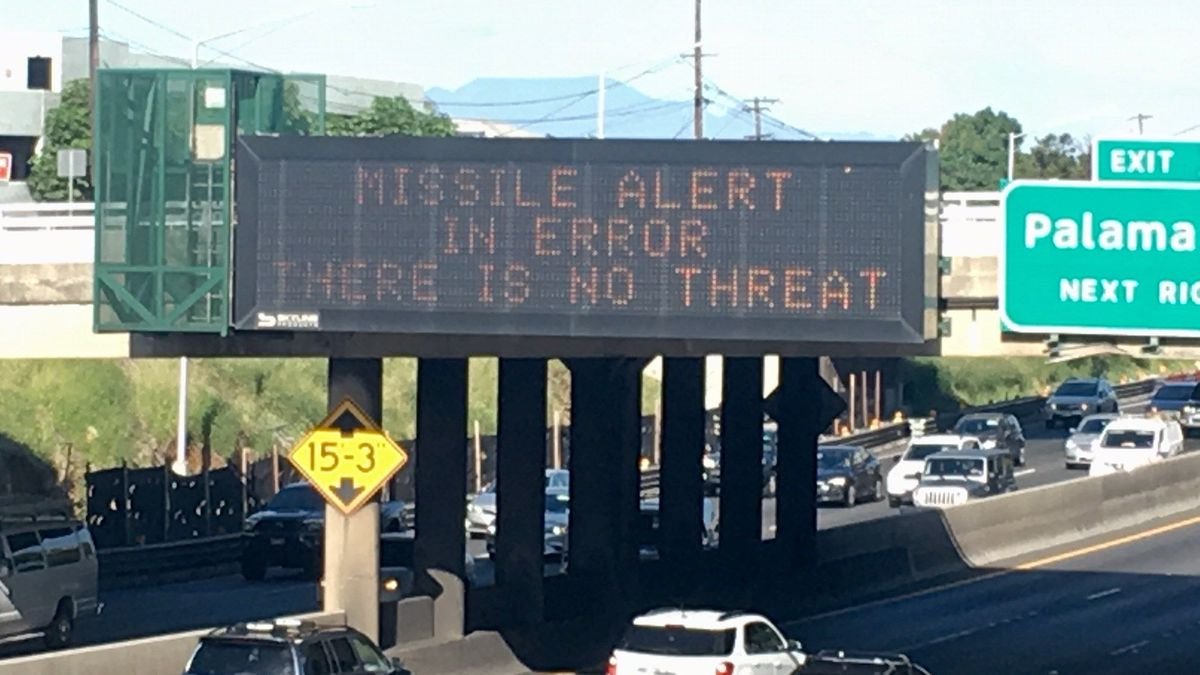 Road sign that reads 'MISSILE ALERT IN ERROR - THERE IS NO THREAT' that was put up by the...