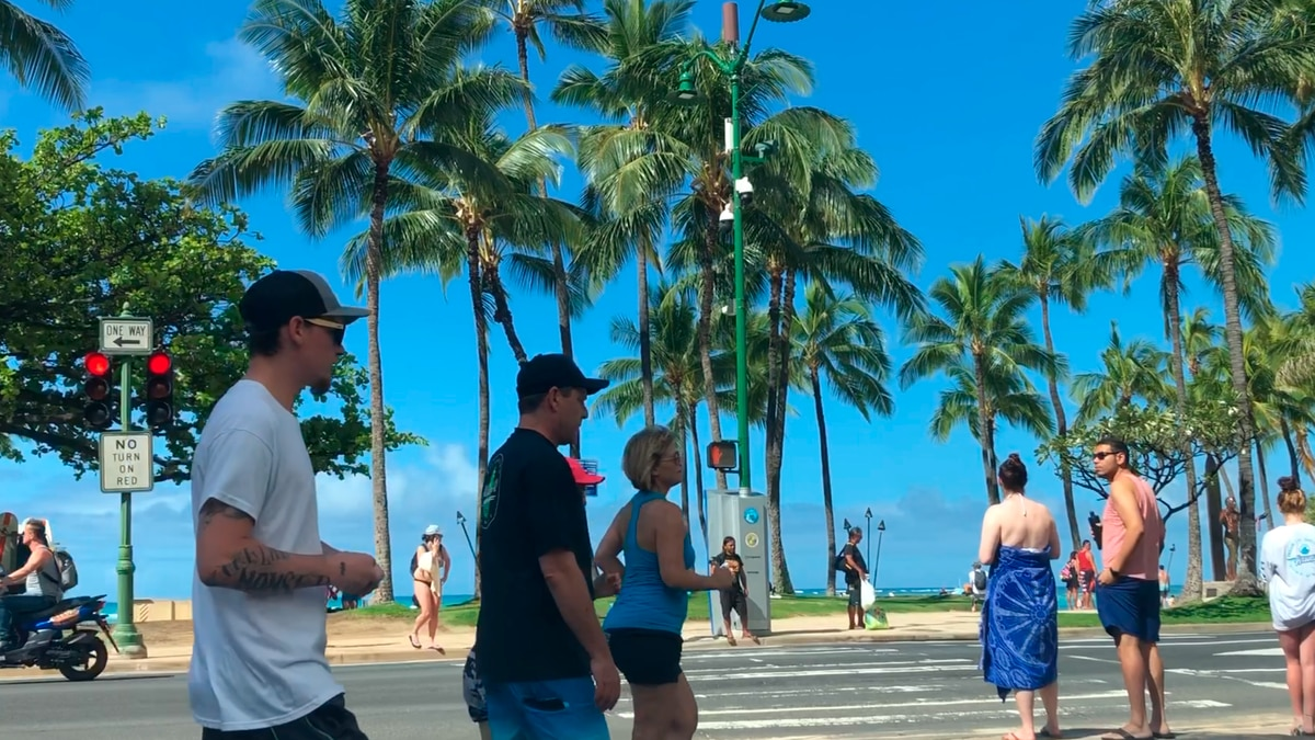 Visitors were still out and about Friday, many walking the shores of Waikiki.