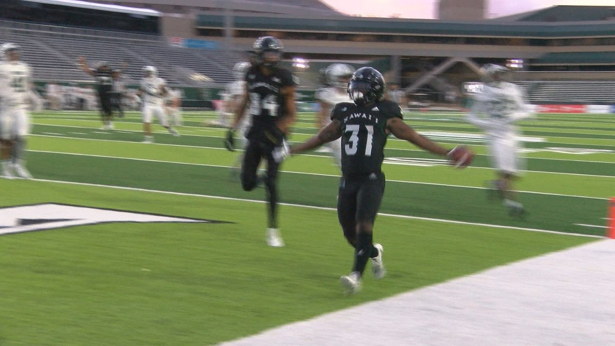 The University of Hawaii Rainbow Warriors football team christened their new home turf with a...