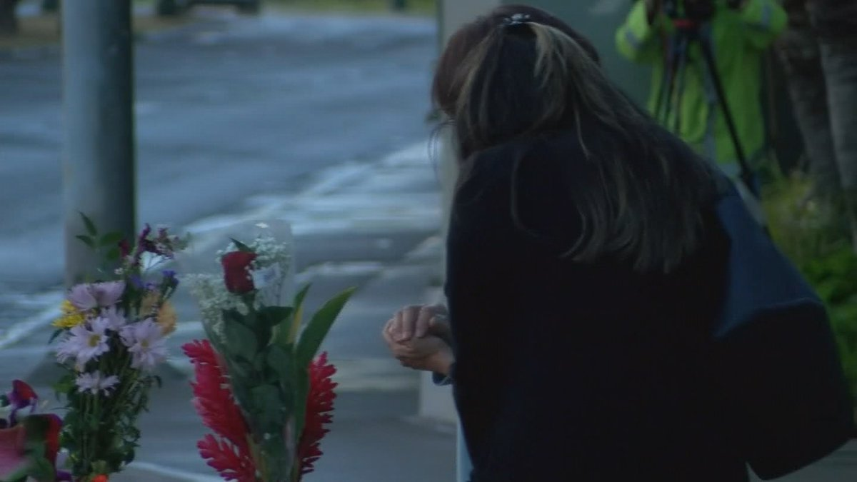 Mourners left flowers and lei at the site of a crash in Kakaako that left three people dead....