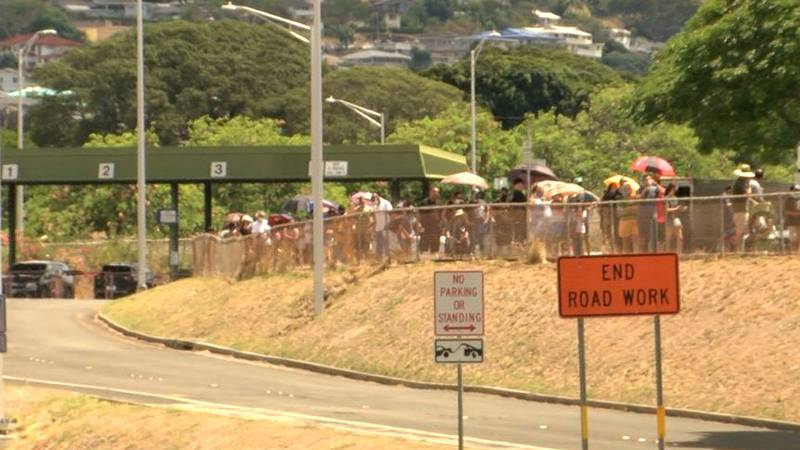Hundreds waited for hours in long lines to get free COVID testing at Aloha Stadium.