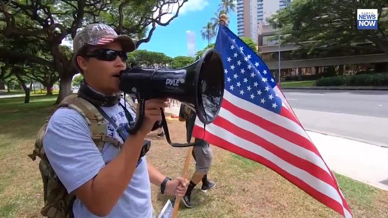 A protestor in Downtown Honolulu on Monday.