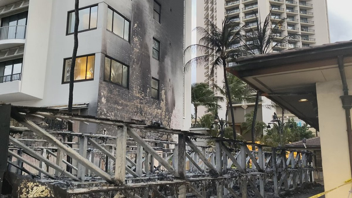 A blaze in Waikiki destroyed surf racks, surfboards and caused damage to a nearby hotel.