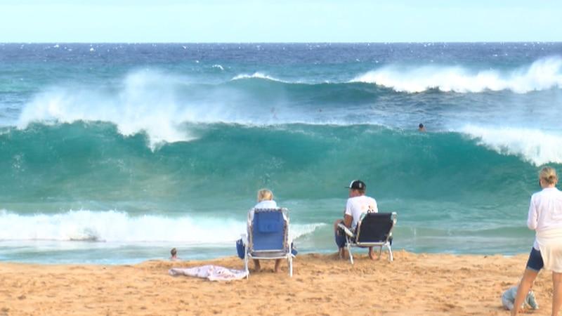 High surf warning signs were put up at Sandy beach.