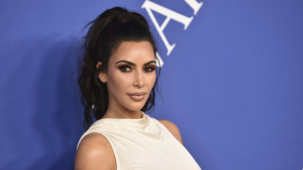 FILE - In this June 4, 2018 file photo, Kim Kardashian West arrives at the CFDA Fashion Awards...