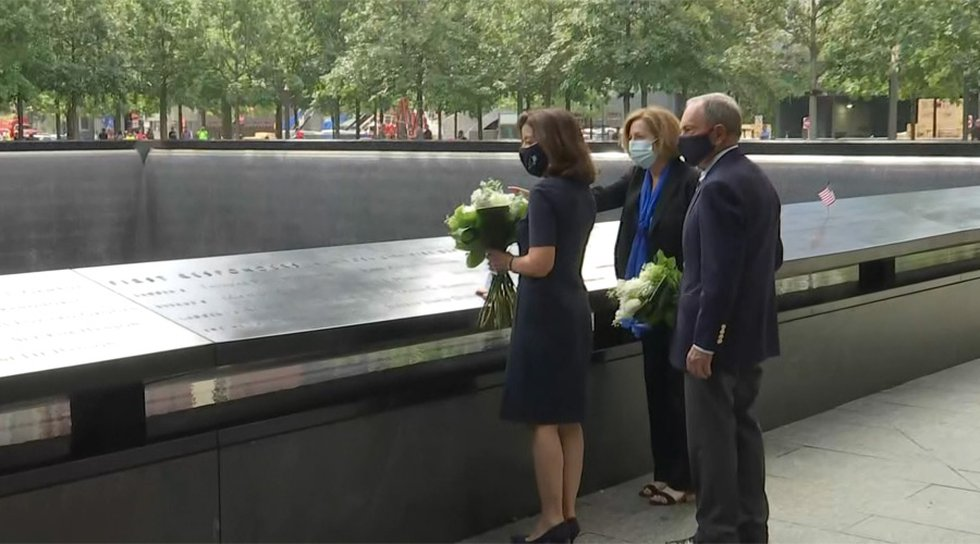 New York Gov. Kathy Hochul, left, joined by former New York City Mayor Michael Bloomberg, pay...