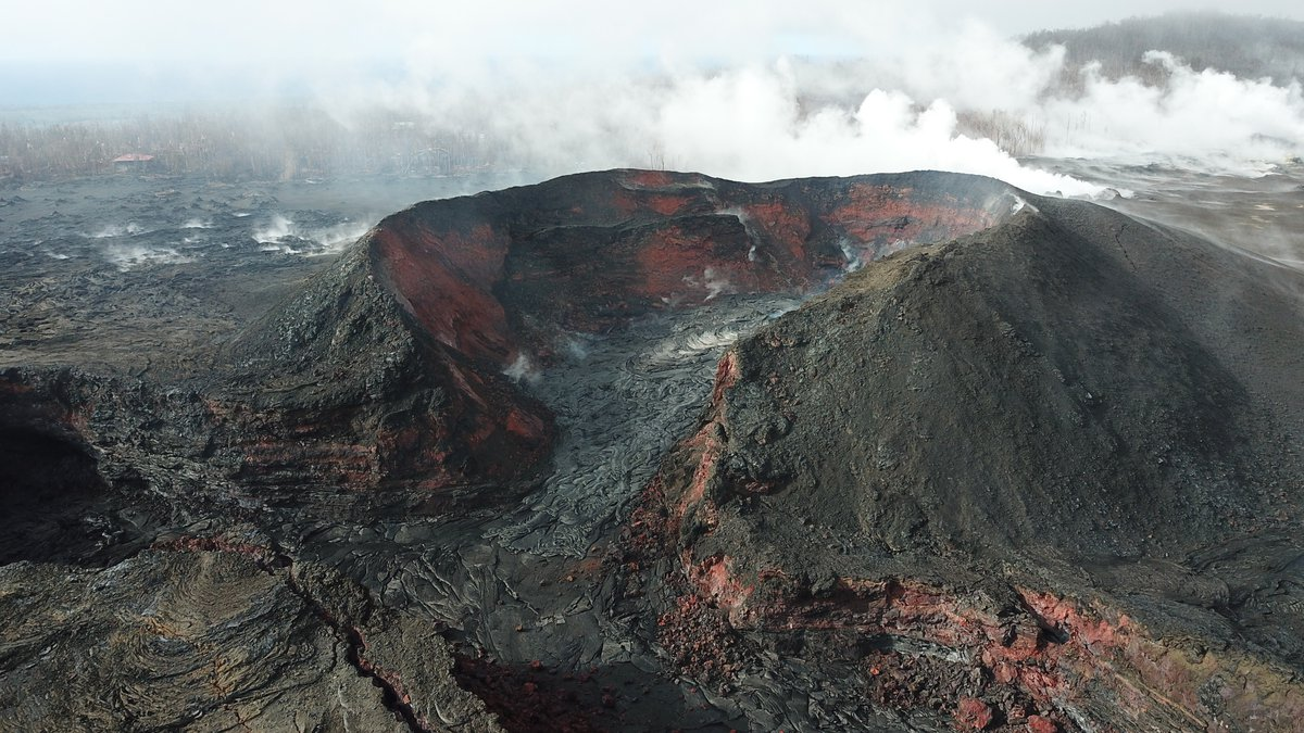 Fissure no. 8 in Leilani Estates created a 180-foot-tall cone where homes and infrastructure...