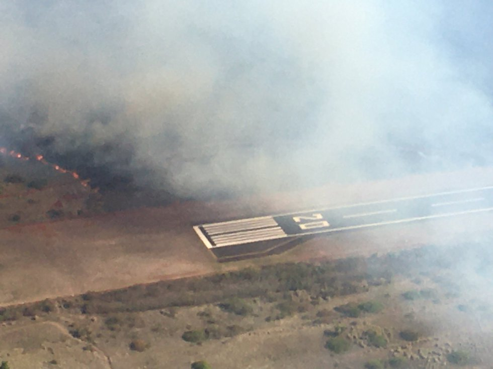 Flames jumped the runway at Kapalua Airport on Tuesday afternoon.
