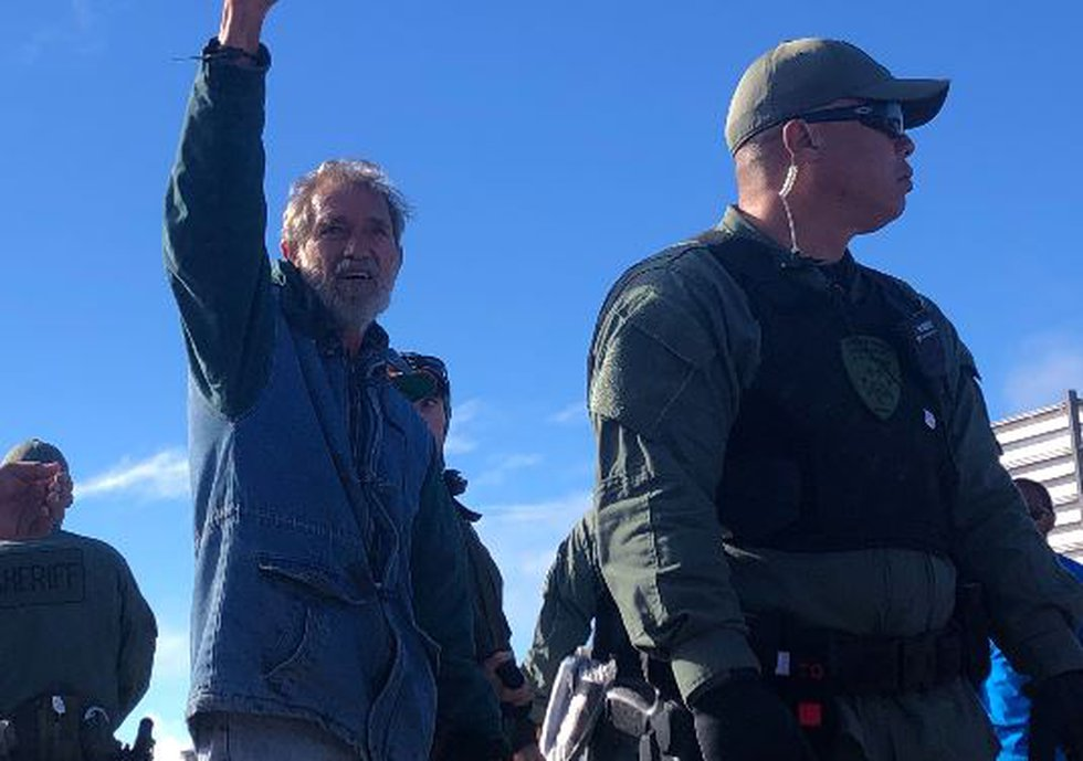 """Native Hawaiian activist raised his fist and yelled """"unity"""" as he was arrested Wednesday..."""
