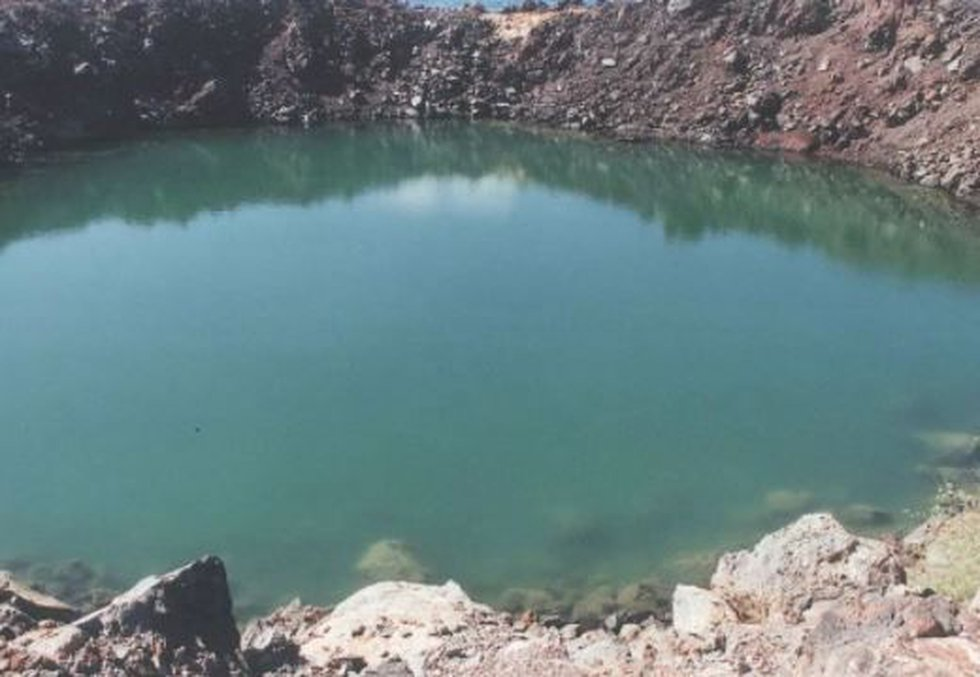 Sailor's Hat crater today is one of the state's largest landlocked ponds and a home for endemic...