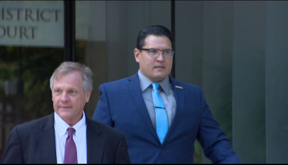 Derek Hahn and attorney Birney Bervar leave federal court