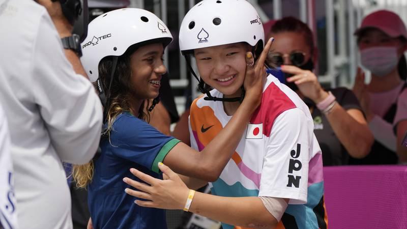 Silver medalist Rayssa Leal of Brazil, left, congratulates gold medal winner Momiji Nishiya of...