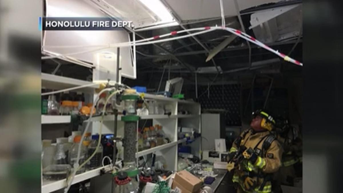 Honolulu firefighter surveys damage after a 2016 lab explosion at UH Manoa